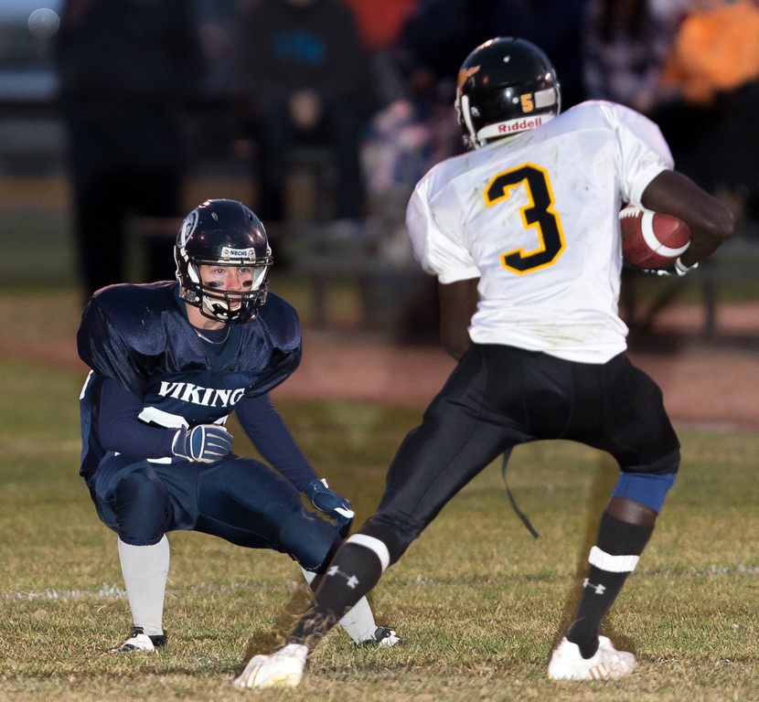 IMAGE: http://rdalrt.smugmug.com/NBCHS/2012-13/Sr-Football-vs-Mount-Royal/i-mQT396R/0/XL/1DX2782-XL.jpg